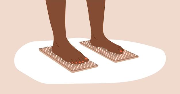 サドゥーボード。アフリカの女性の足は爪の上に立っています。