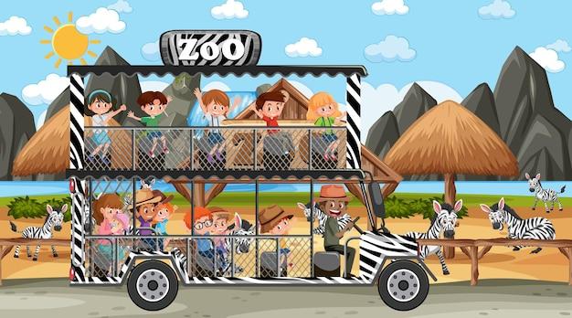 Сафари в дневное время с детьми, наблюдающими за группой зебры