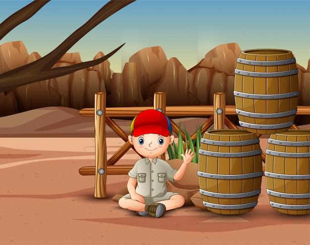 Safari boy sitting near the barrels