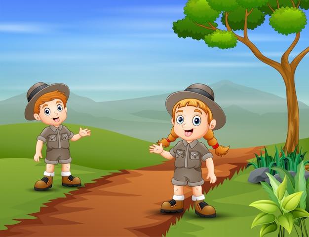 The safari kids at nature landscape
