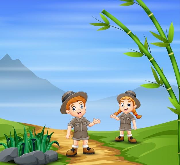 Safari kids walking on the path road