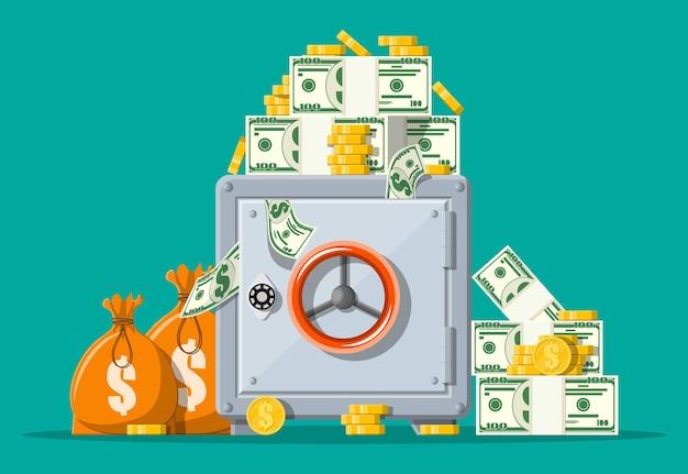 Сейф вид спереди. закрытый серебряный металлический сейф с деньгами. золотые монеты, стопки долларовой наличности