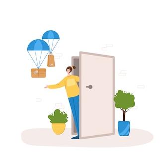 安全な配達のコンセプト-製品または小包を自宅から玄関まで非接触で配達