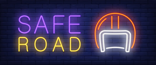 Safe road neon text with helmet