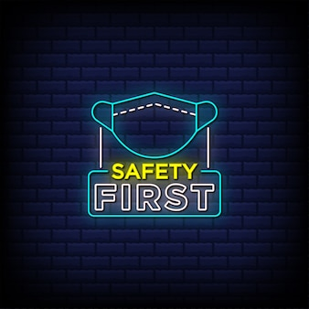 Safety first neon signs style text with face mask icon