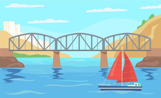 Парусник с красным парусиной плывет под мостом