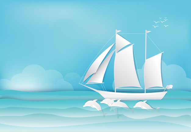 Sailing ship and dolphin in the sea background
