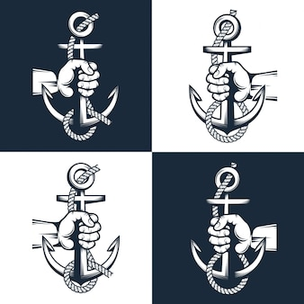 Sailor hand holds an anchor with rope