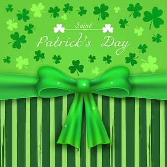 Saint patrick's day green background with shamrocks and realistic bow