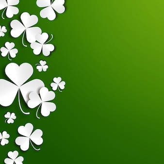 Saint patricks day background with paper shamrock leaves
