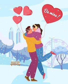 Поздравительная открытка дня святого валентина. пара в любви, обниматься в зимнем парке с воздушными шарами в форме сердца под снегопадом.