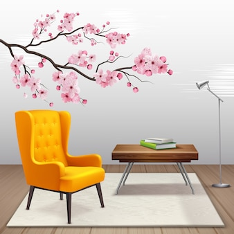 Sakura interior composition with cherry twig in the house next to armchair and coffee table