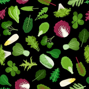 Salad green vegetables lettuce leaves and herbs background