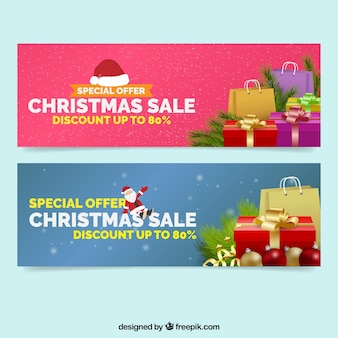 Sale banners with shopping bags and gifts