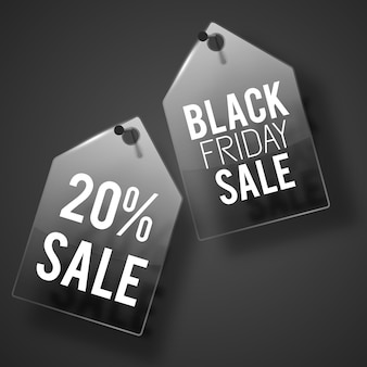 Sale black tag set hanging on the dark gray wall with headlines on each
