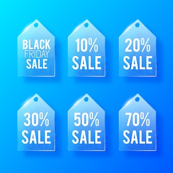 Sale glass price tags set with inscriptions and different discount percent rates on blue.