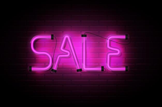 Sale glowing neon pink tubes on dark brick wall background