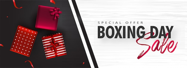 Sale header or banner with top view of gift boxes on black and white texture for boxing day.