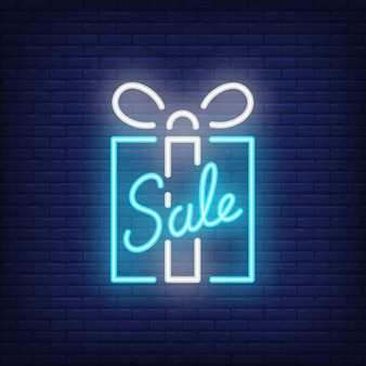 Sale neon sign with blue gift box. Night bright advertisement.