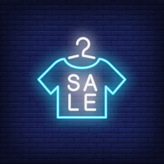 Sale neon sign with tshirt shape. Night bright advertisement.