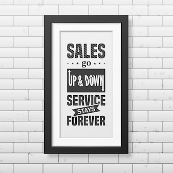 売上高は上下し、サービスは永遠に続きます-レンガの壁の背景に現実的な正方形の黒いフレームで誤植の背景を引用します。