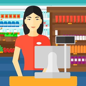Продавщица стоит на кассе