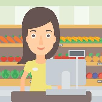 Продавщица стоит на кассе.