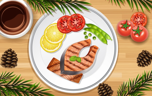 Стейк из лосося крупным планом на фоне стола с овощным реквизитом