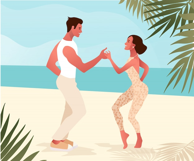 Salsa on a beach, summer dance party. beautiful young couple dancing outdoor.