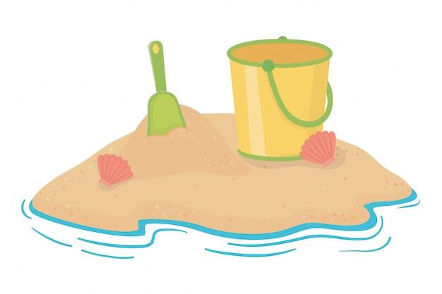 夏とビーチの砂のバケツ