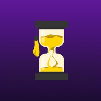 Песочные часы в шляпе выпускника и золотом песке