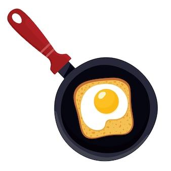 Сэндвич с ломтиком хлеба и жареным яйцом на сковороде
