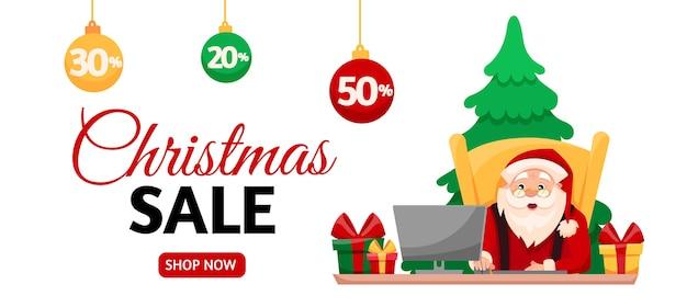 サンタクロースは、クリスマスセールの時期にオンラインでギフトを購入します。ホリデーセール横バナー。