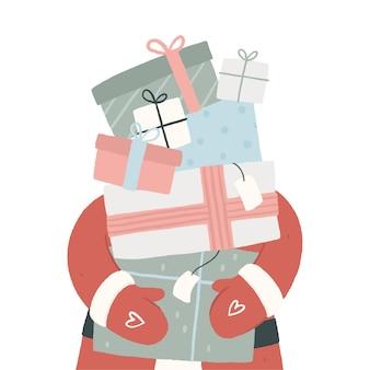 クリスマスのギフトボックスの背の高いスタックを運ぶサンタクロース