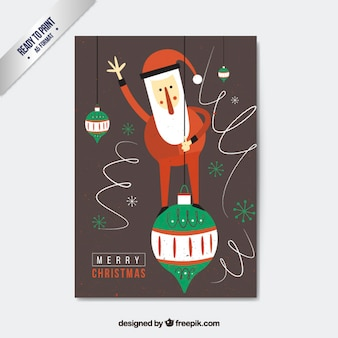 Santa claus on a christmas ball card Free Vector