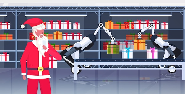 Santa claus controlling industrial robots loading gift present boxes on conveyor belt merry christmas happy new year celebration
