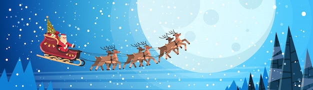 Santa claus flying in sledge with reindeers night sky over moon for christmas