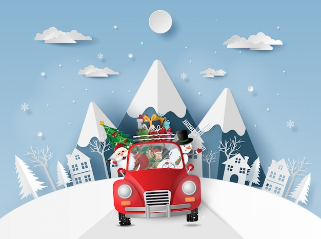 Santa claus and friends in red car in the village
