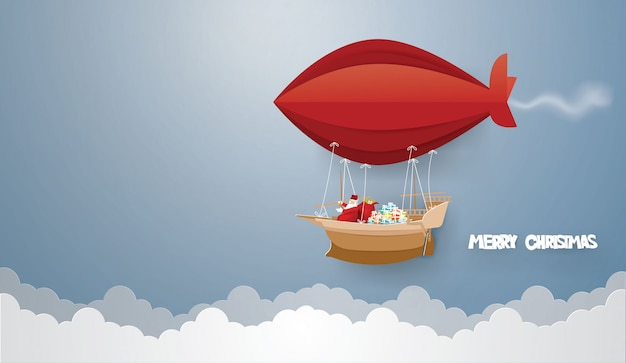 Santa claus and gift box in the barque on the sky in winter season