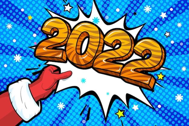 サンタクロースが赤いスーツを着て、2022年に単語の泡を示すミトン