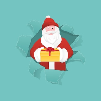 Santa claus holding a gift box and peeking from ripped paper hole