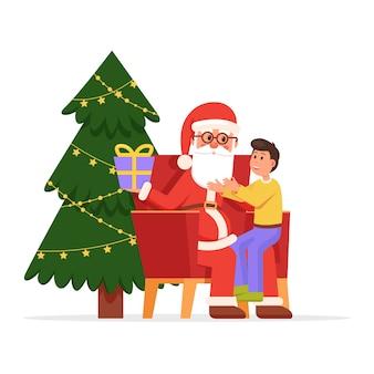 Санта-клаус держит маленького улыбающегося мальчика на коленях