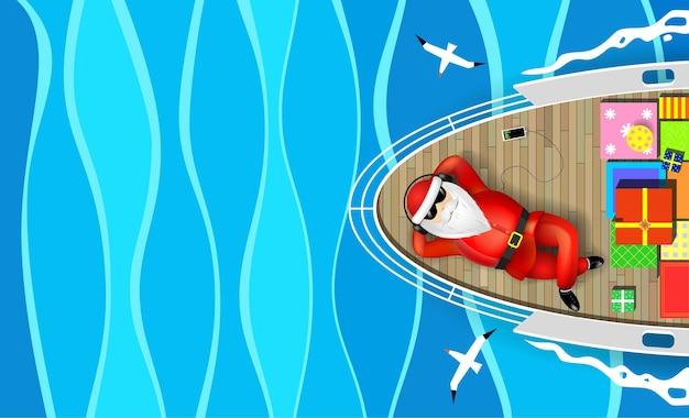 サンタクロースはデッキに横たわっているヨットで泳いでいます