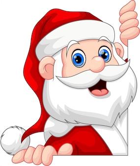 Santa claus peeking behind a wall smiling