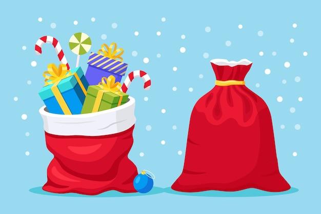 背景に分離されたギフトボックスとサンタクロースの赤いバッグ。プレゼントパッケージがいっぱいのクリスマスサック