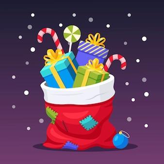 Санта-клаус красный мешок с изолированной подарочной коробке