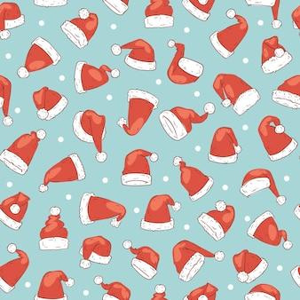 サンタクロースの赤い帽子のシームレスパターン