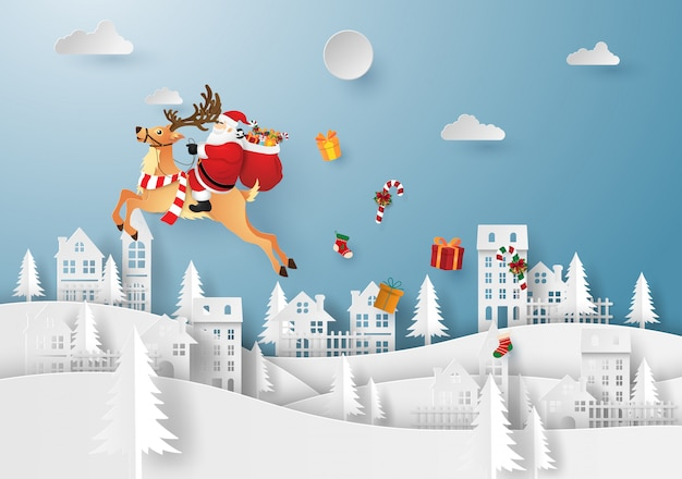 Santa claus and reindeer in the village