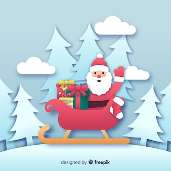 Santa claus on sleigh in paper style