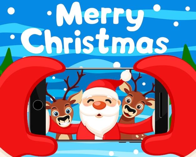 Санта-клаус делает селфи с оленями на своем телефоне. рождественский фон